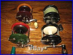 3 Odd Color Penn reels and an Anglesea reel