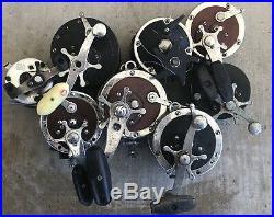 Lot of 8 Vintage Fishing Reels- Penn Senator 112 113 h Long Beach 67 Jig 501 555