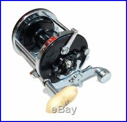Penn 150 Surfmaster multiplier reel, old shop stock with box spares and catal