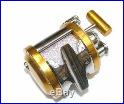 Penn International 12 gold multiplier reel superb condition with braid line