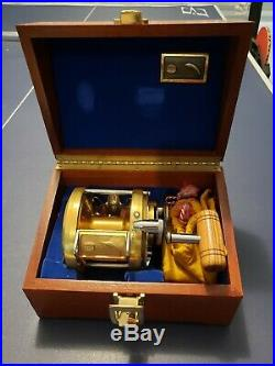 Spectacular scarce Penn International 50th Anniversary big game reel in wood box