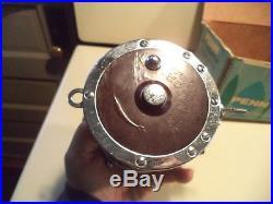 Vintage PENN 114-H 6/0 SENATOR Big Game Saltwater Fishing Reel With Rod Clamp