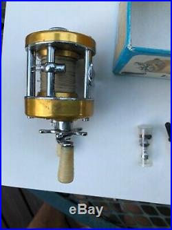 Vintage PENN 910 LEVELMATIC Fishing REEL baitcast casting Withbox Extras Nice Cond