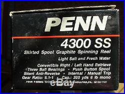 Vintage Penn 4300SS Graphite Spinning Reel withbox, parts list, manual, excellent