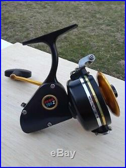 Vintage Penn 704Z Spinning Reel Lefty BLACK/GOLD NICE WORKING Cond Made in USA