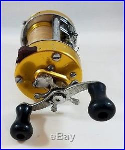 Vintage Penn 940 Levelmatic Fishing Reel Gold Marine Casting Ball Bearings