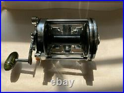 Vintage Penn Squidder 140 Fishing Reel With rod Clamp. Made in the USA